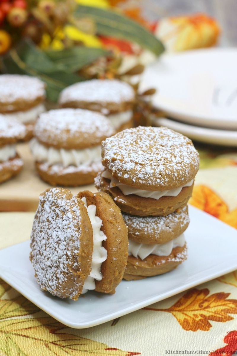Pumpkin Gingerbread Whoopie Pies Recipe on a leafy patterned cloth.