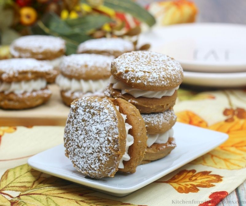 Pumpkin Gingerbread Whoopie Pies Recipe on a squared serving plate.