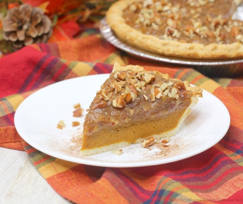 Pumpkin Pecan Pie Recipe on a multi-colored cloth.