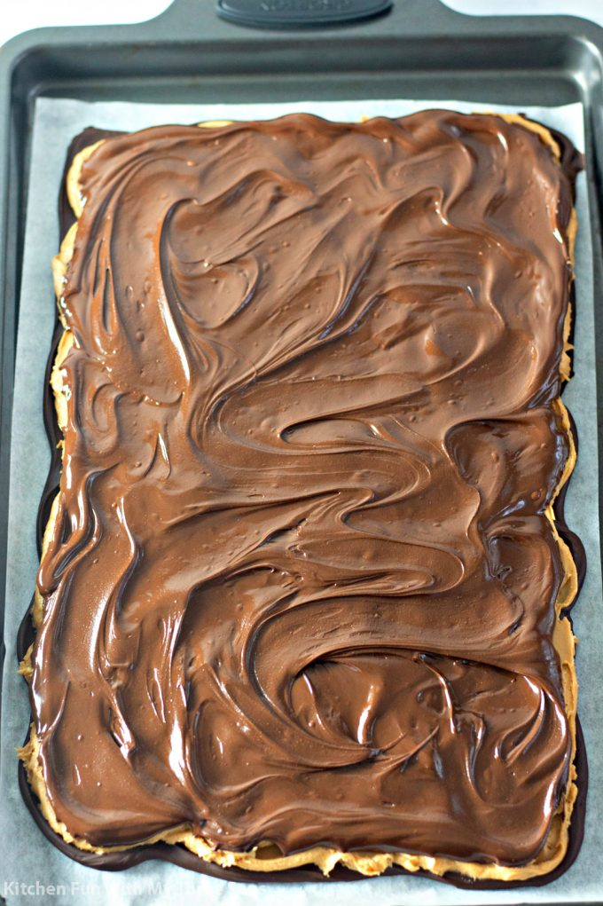 topping the bark with melted chocolate