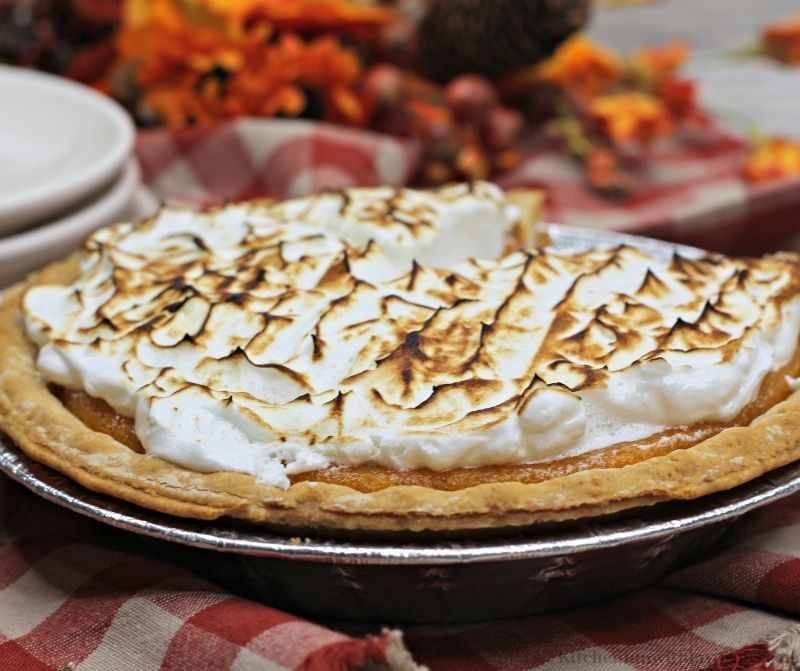 Sweet Potato Pie Recipe with Marshmallow Meringue in a aluminum pan.