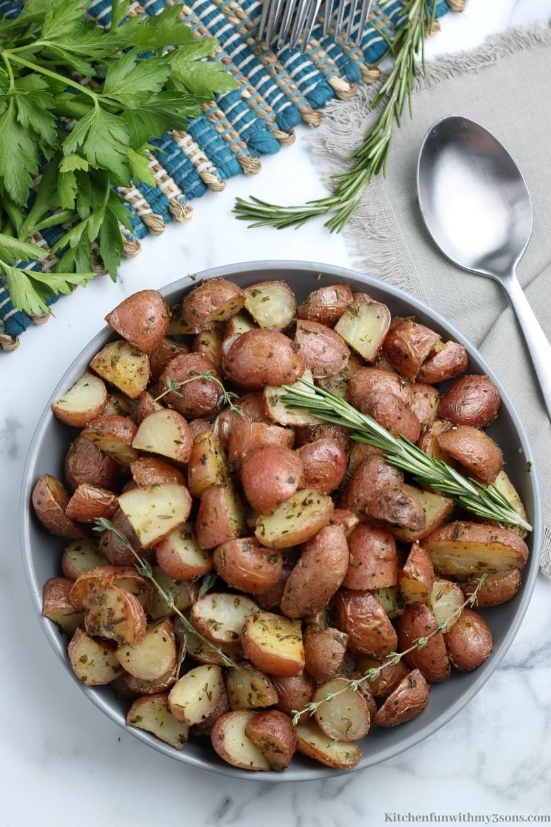 The Best Oven Roasted Potatoes in a serving bowl with a side of cilantro.