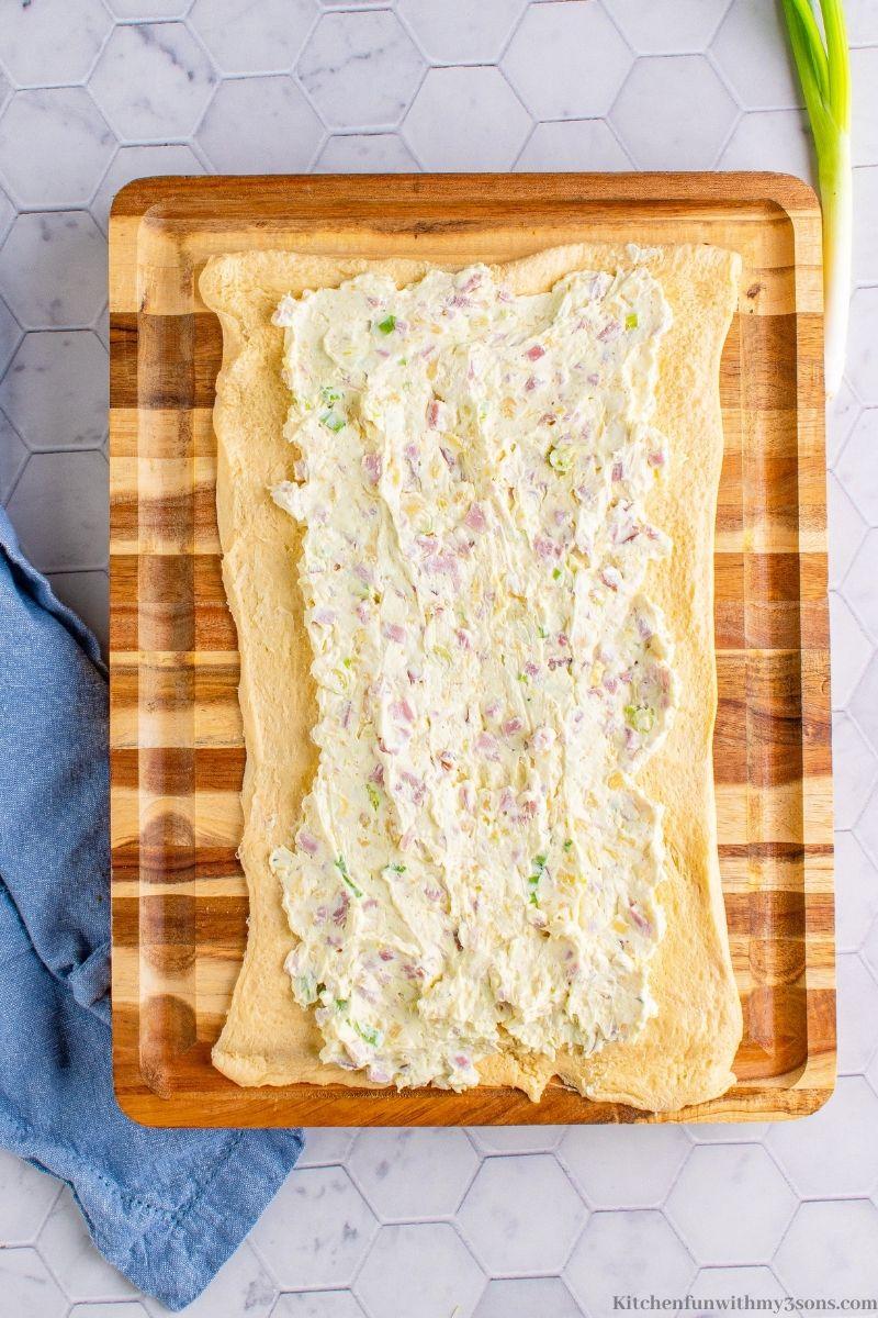 Your cream cheese mixture spread onto the dough.