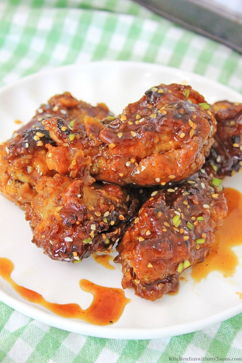 Air Fryer Korean BBQ Chicken Wings on a green and white checkered cloth.