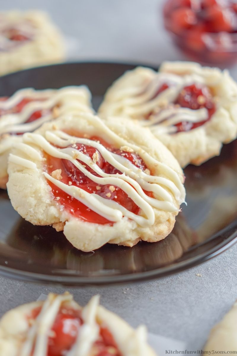 Cherry Cheesecake Cookies on a black serving plate.