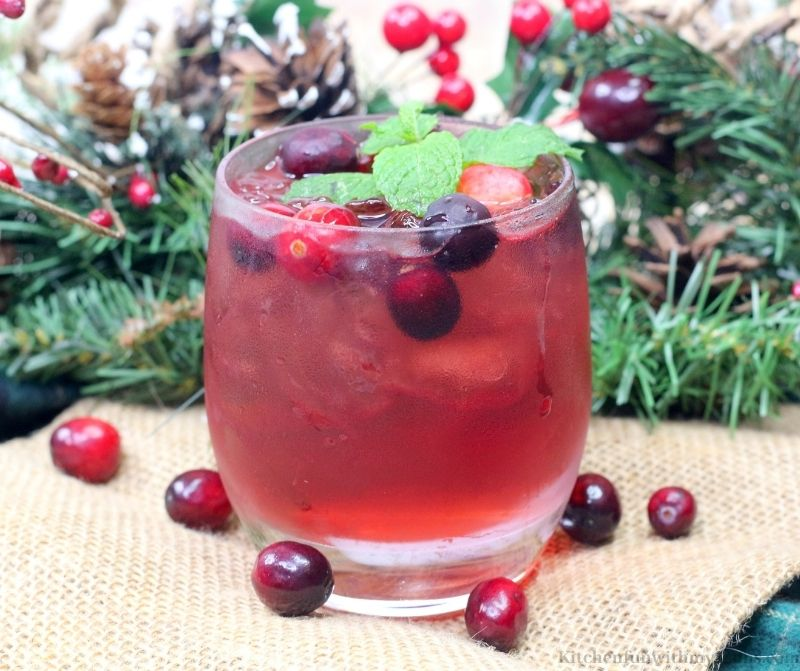 Cranberry Spritzer with Tequila topped with fresh cranberries and mint.