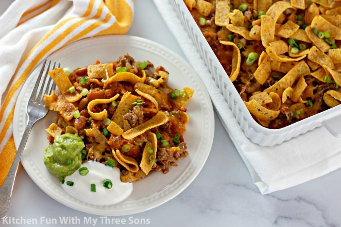 Easy Fritos Pie Recipe on a white plate with a fork