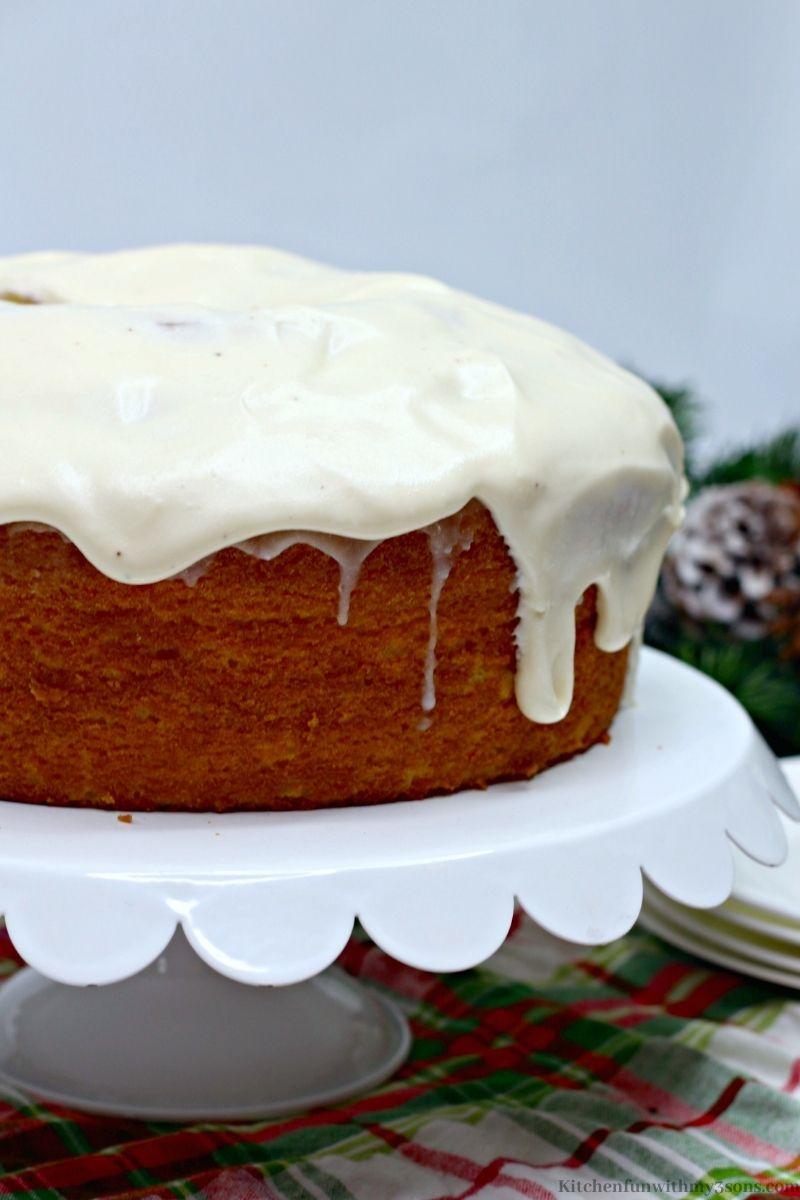 The whole Eggnog Cake on a serving platter.