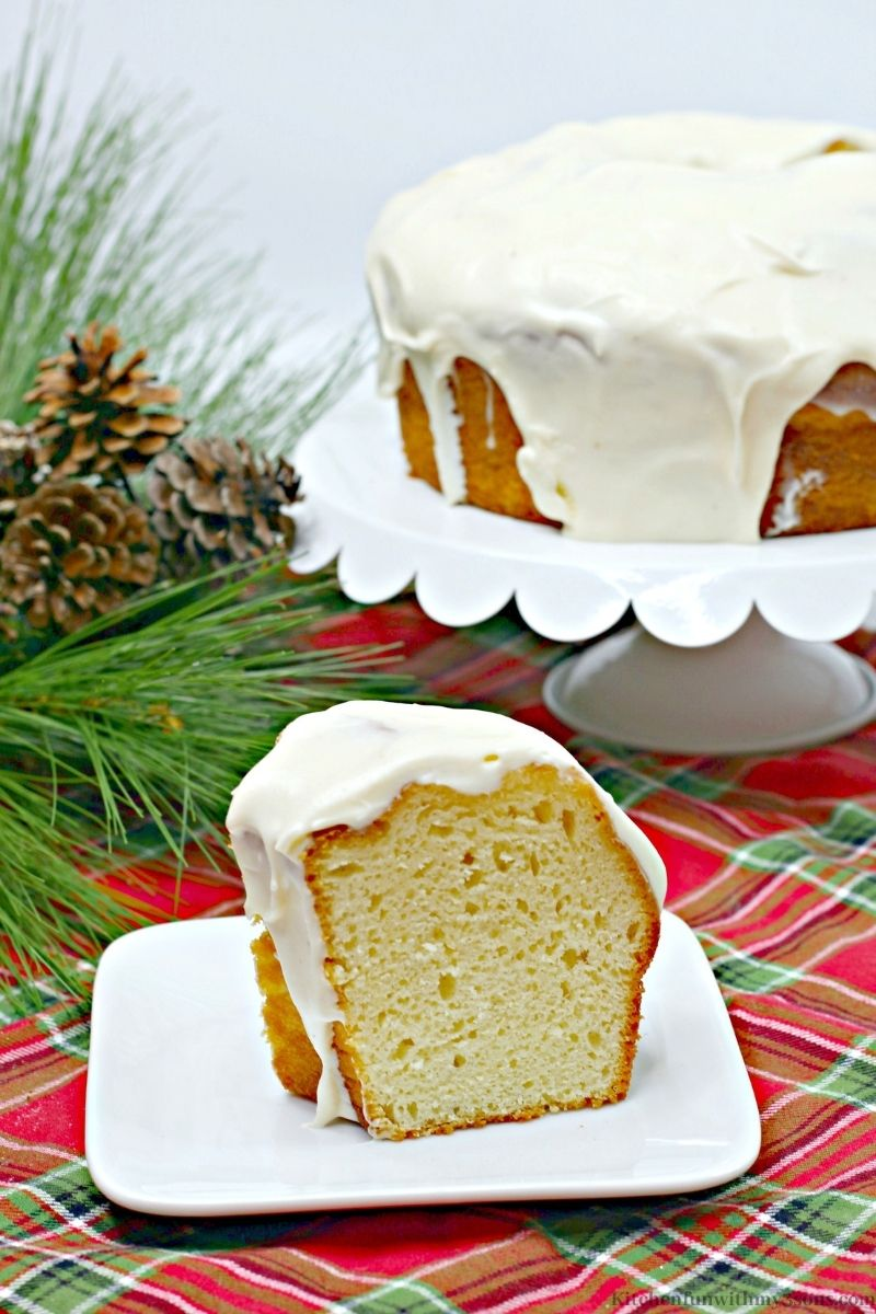 A slice of the Eggnog Cake on a patterned cloth.