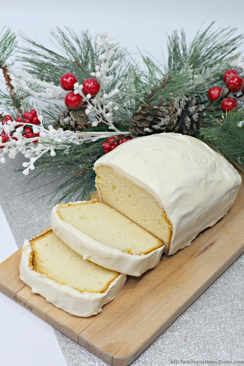 Eggnog Quick Bread on a wooden platter.