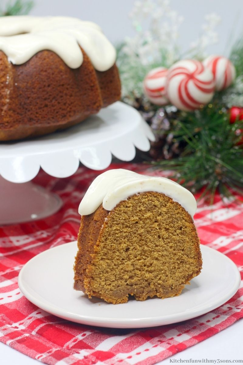 A slice of the Gingerbread Bundt Cake on a red patterned cloth.