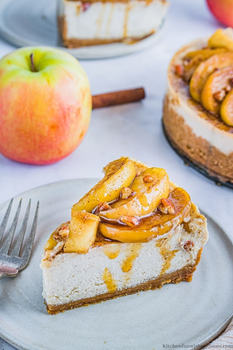 Instant Pot Apple Cinnamon Cheesecake on a serving plate.