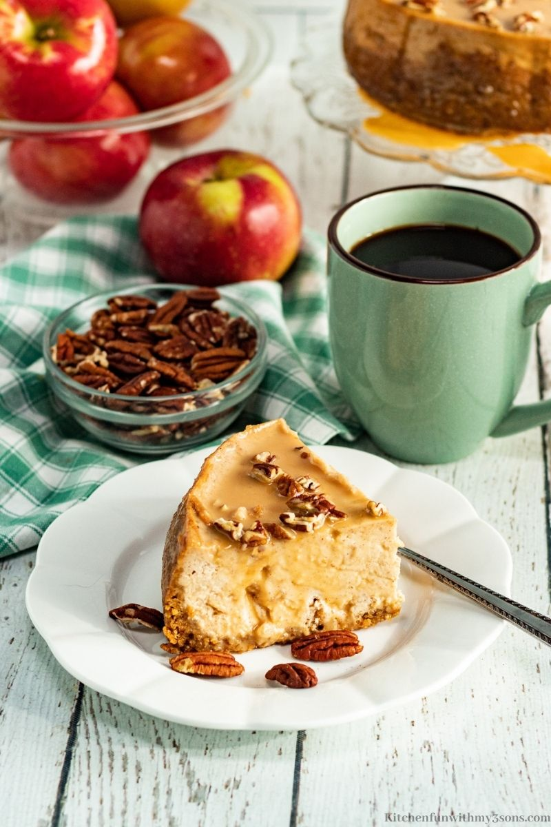 Instant Pot Caramel Apple Cheesecake with a mug of coffee.