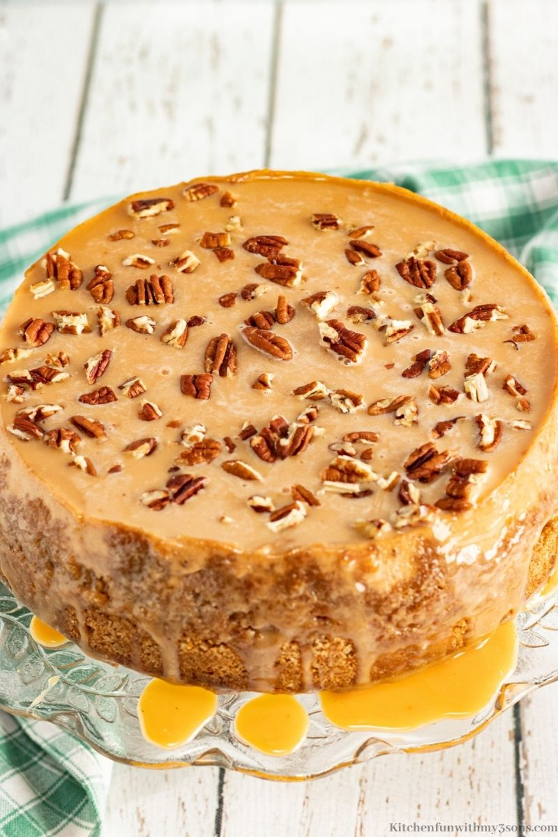 Instant Pot Caramel Apple Cheesecake on a serving platter stand.