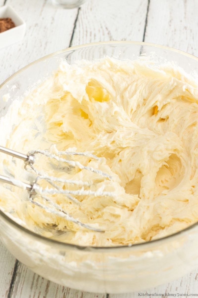 Beating the cream cheese in a mixing bowl.