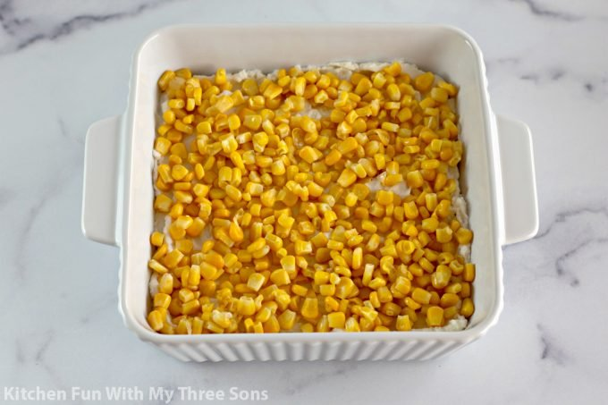 corn over top of the mashed potatoes