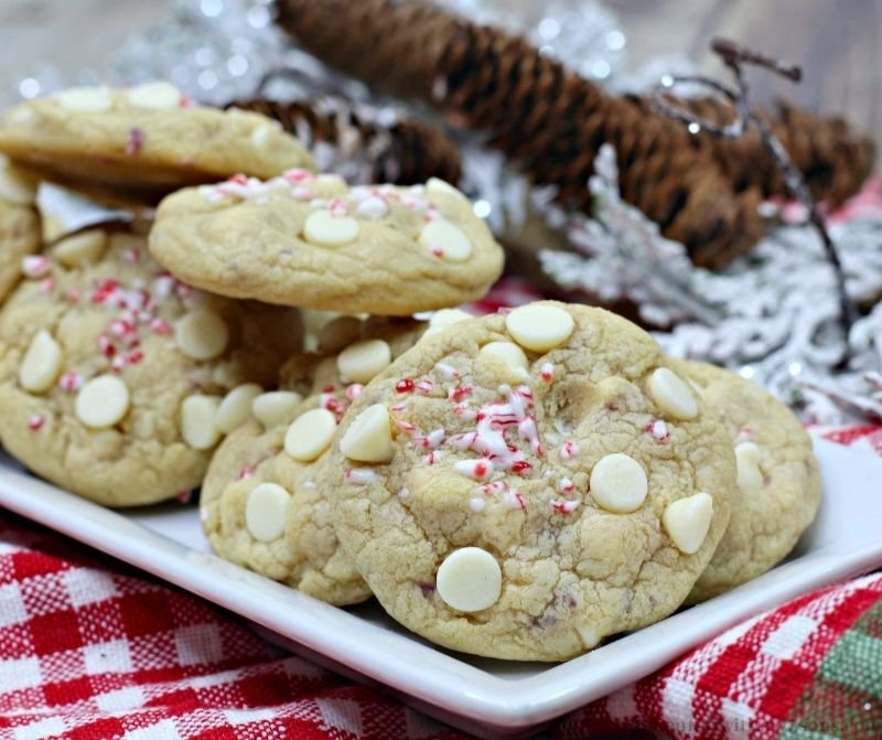 Peppermint White Chocolate Chip Cookies on a patterned cloth.