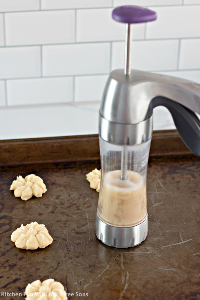 using a cookie press to make shortbread cookies