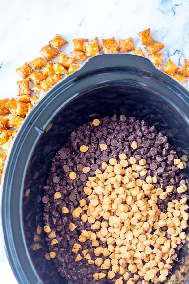 The peanut butter and chocolate chips in the slow cooker.