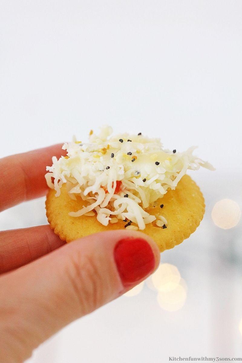 Cheese spread onto a cracker.