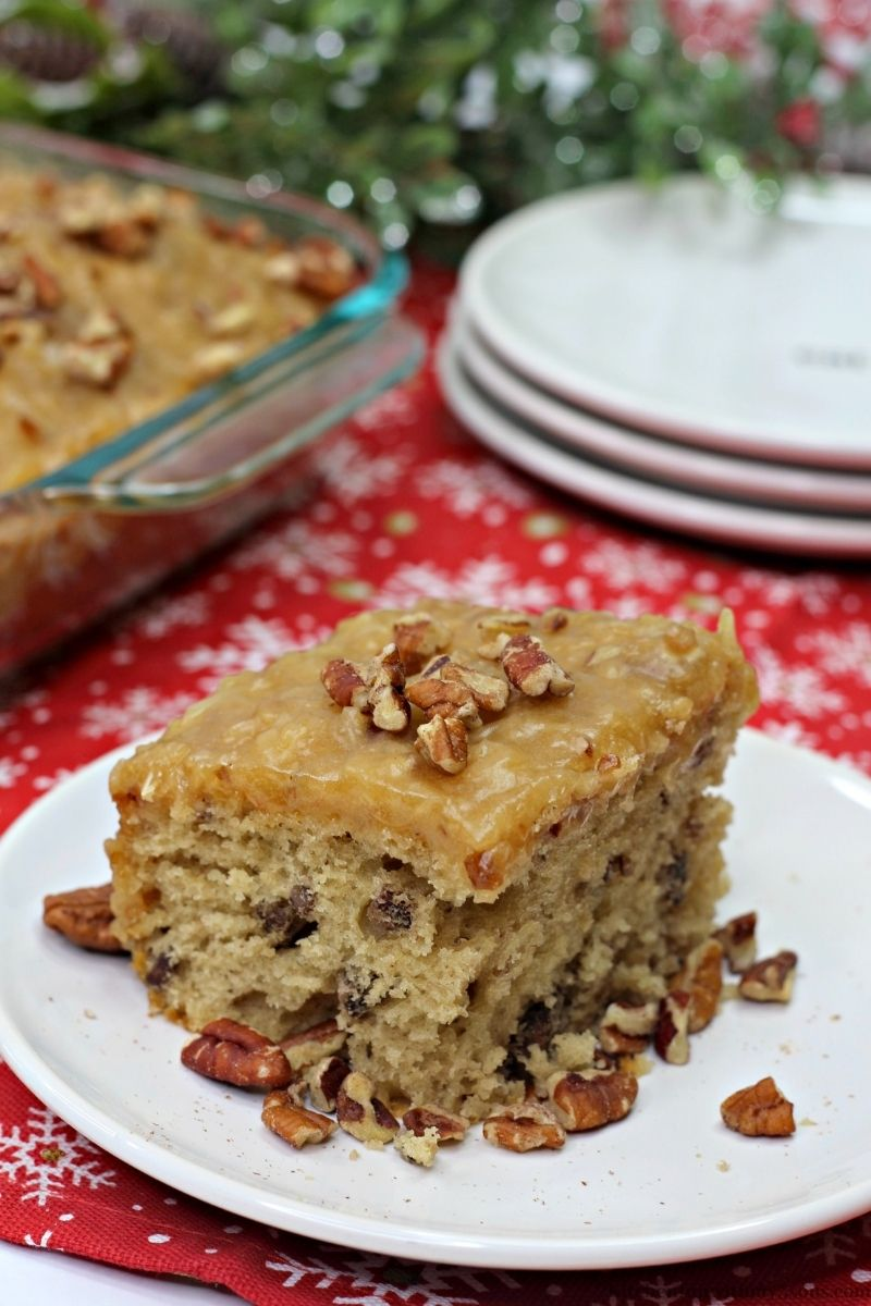 Butter Pecan Sheet Cake topped with chopped pecans.