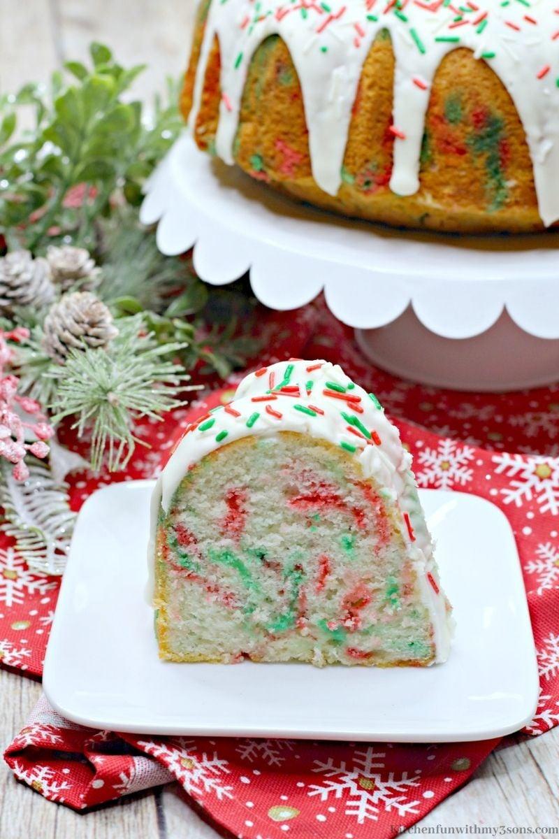 Christmas Funfetti Bundt Cake on a Christmas cloth.