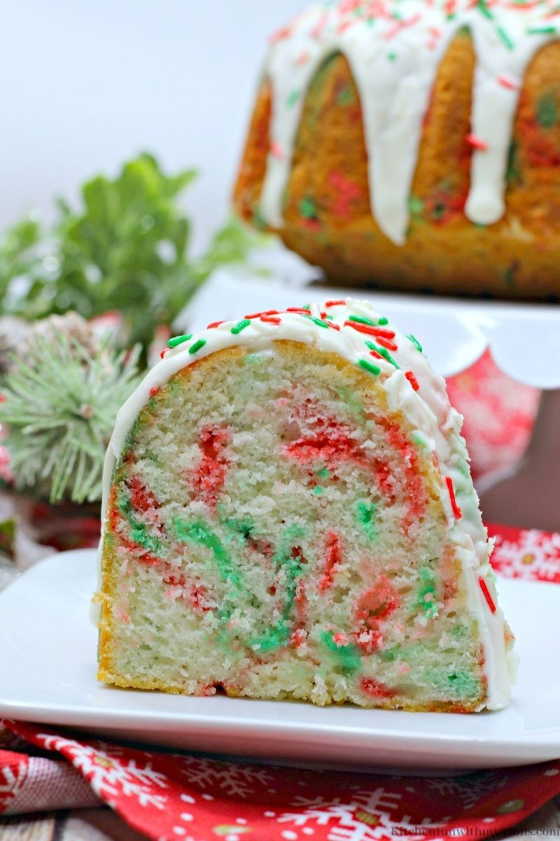 A close up of one slice of the Christmas Funfetti Bundt Cake.