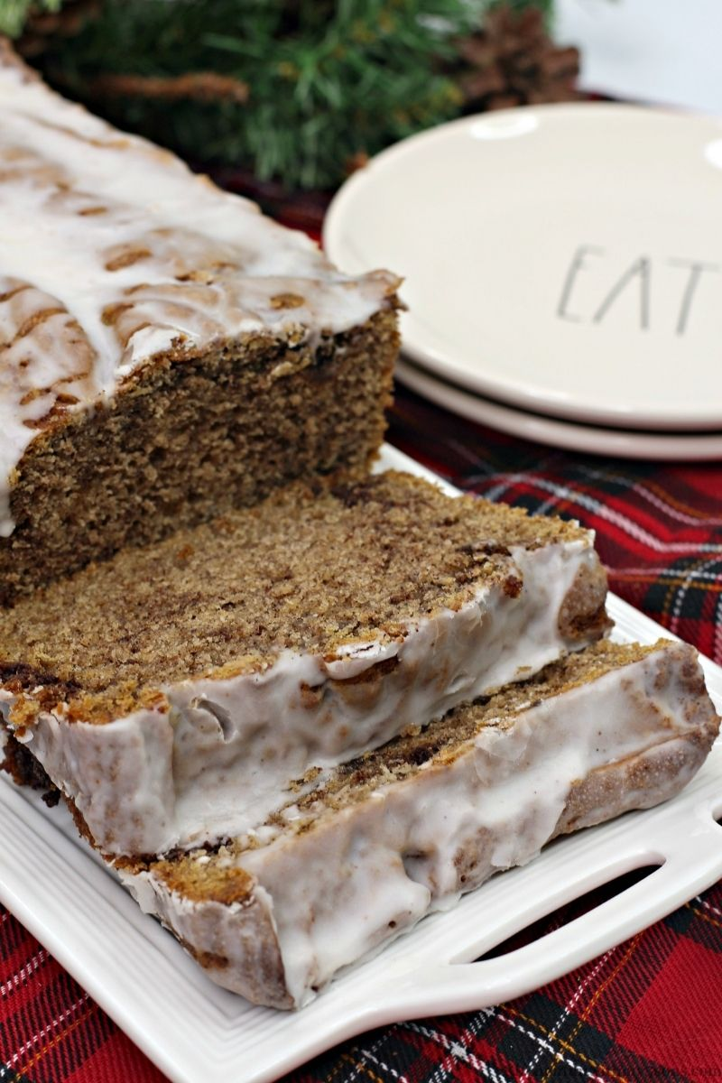 Cinnamon Bread Recipe with Icing with fun named serving plates next to it.