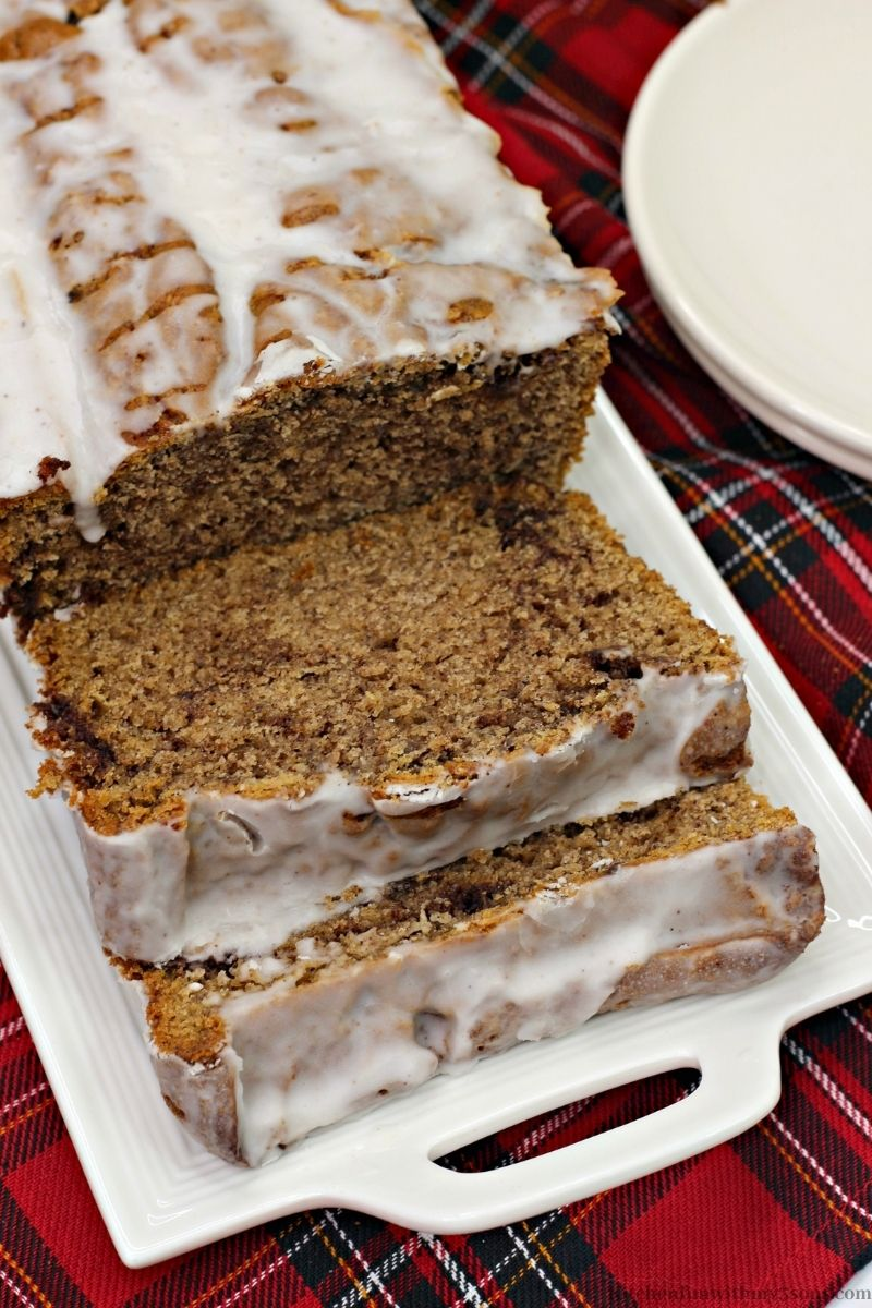 Cinnamon Bread Recipe with Icing on a patterned cloth.