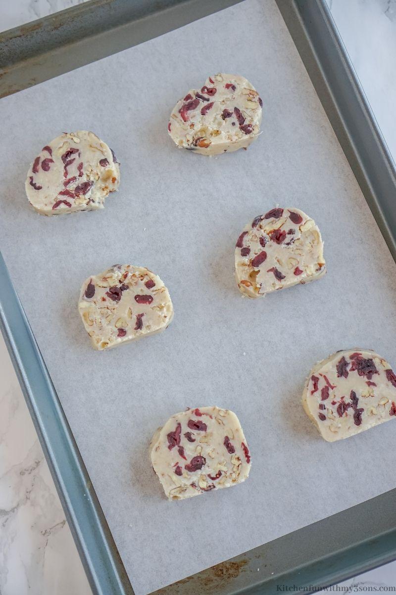 Cutting and arranging the dough onto a sheet pan.
