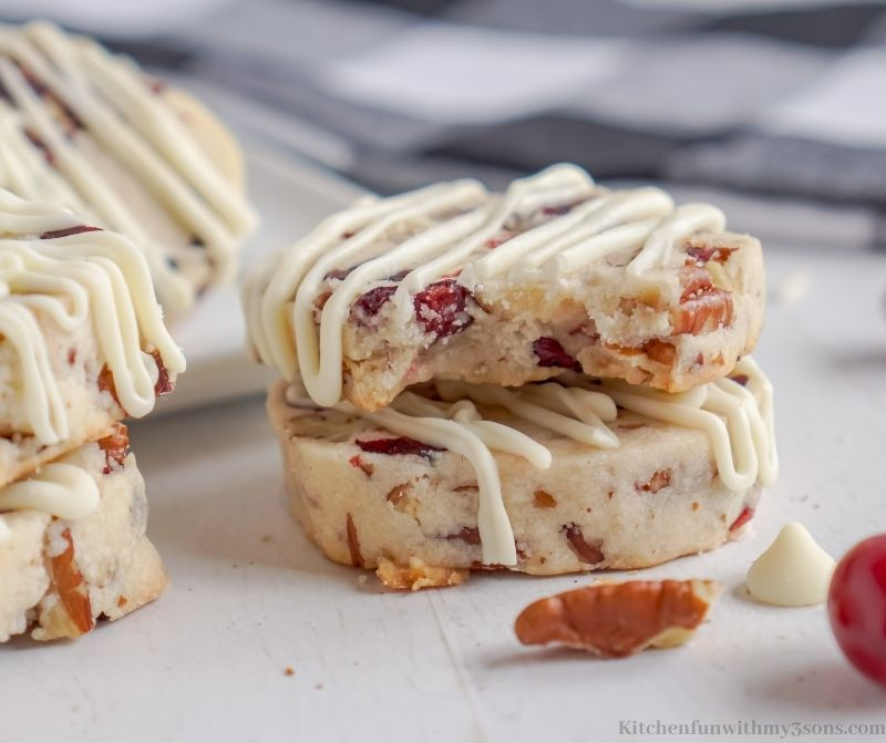 Cranberry Shortbread Cookies stacked on top of each other.