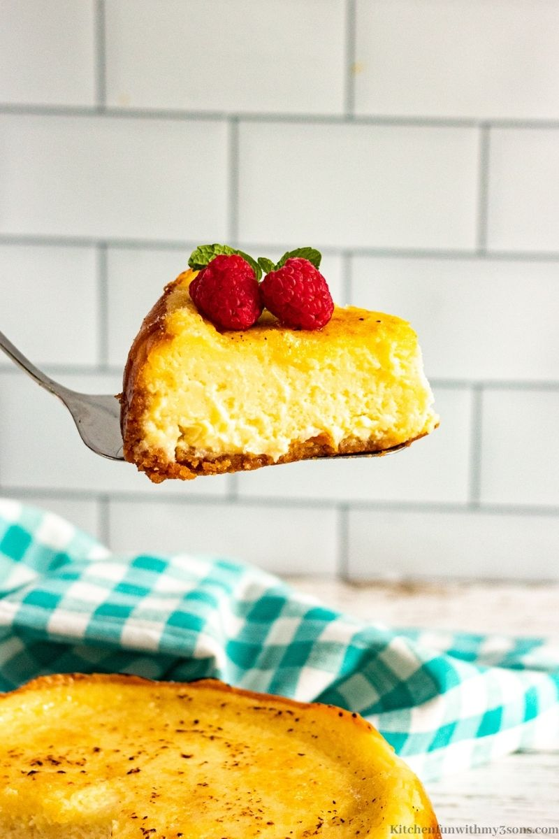 A spatula lifting up a slice of the Crème Brule Cheesecake.