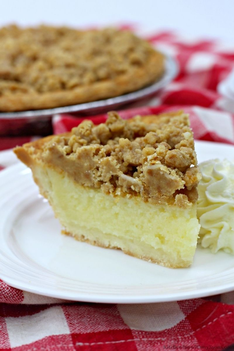 Crumble Eggnog Pie with a dollop of whipped cream next to it.