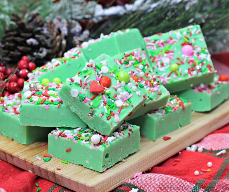Easy Holiday Grinch Fudge on a wooden board.