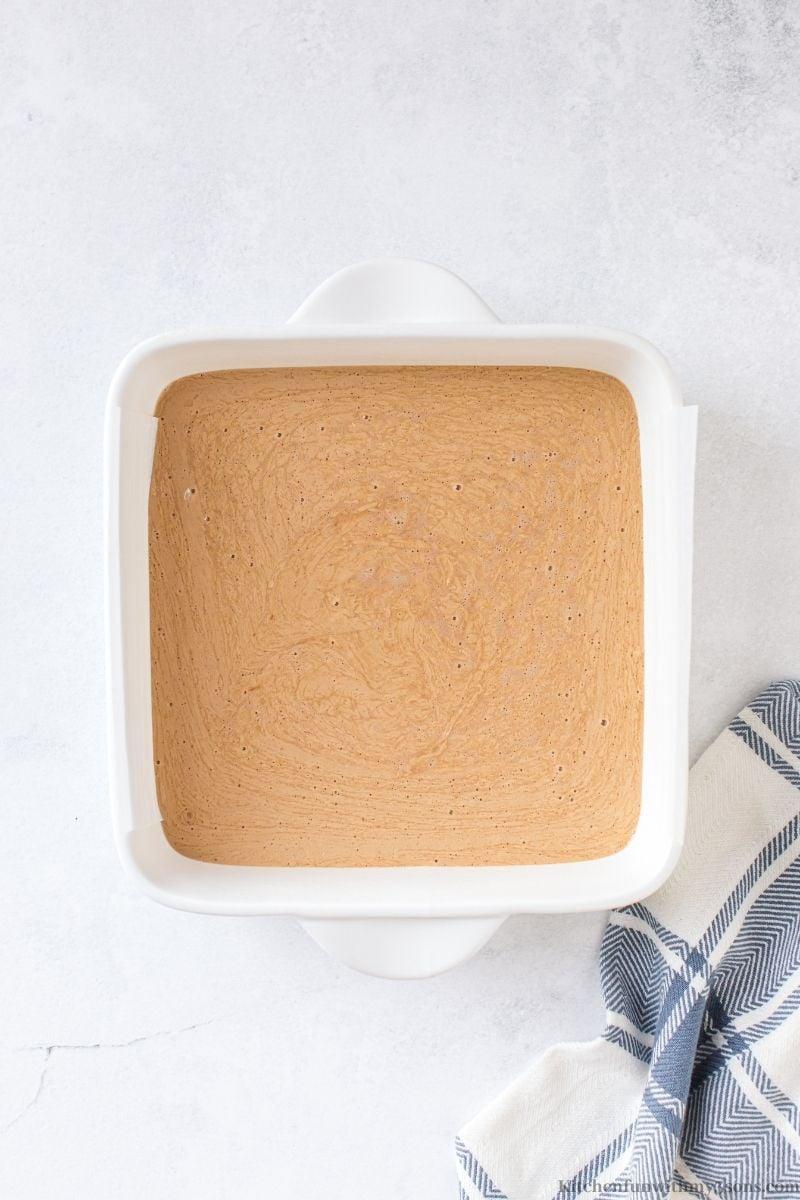The fudge batter inside the prepared pan.