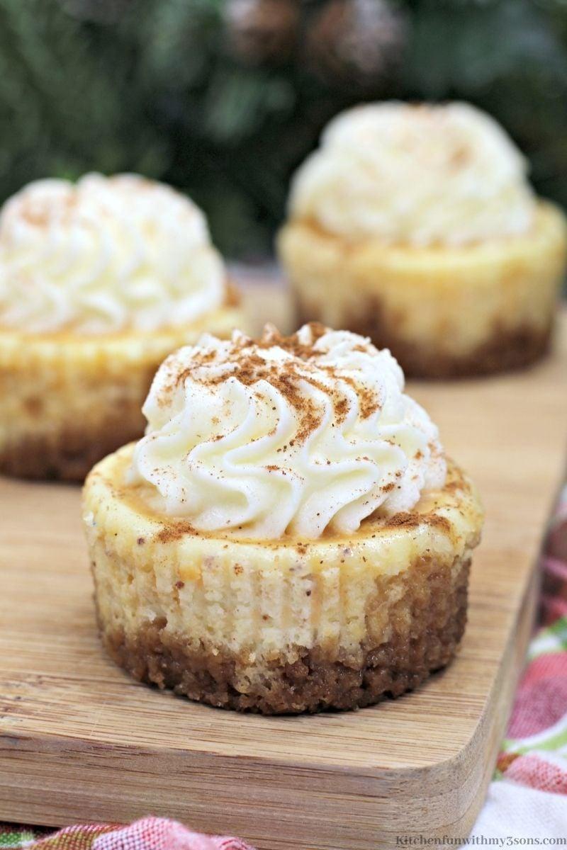 Eggnog Mini Cheesecake Recipe on a patterned cloth.