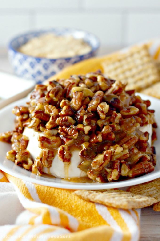 Pecan and Cream Cheese French Quarter Dip on a white plate with crackers