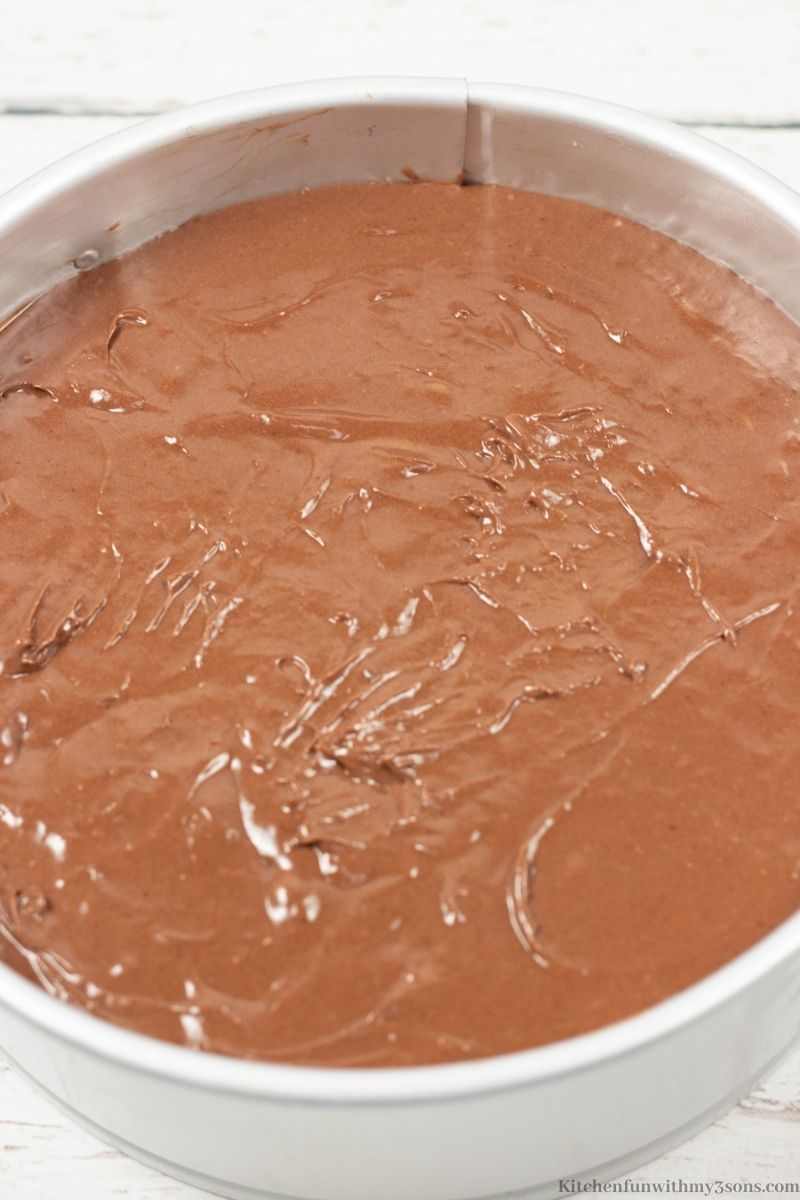 Adding the chocolate layer to the pan.