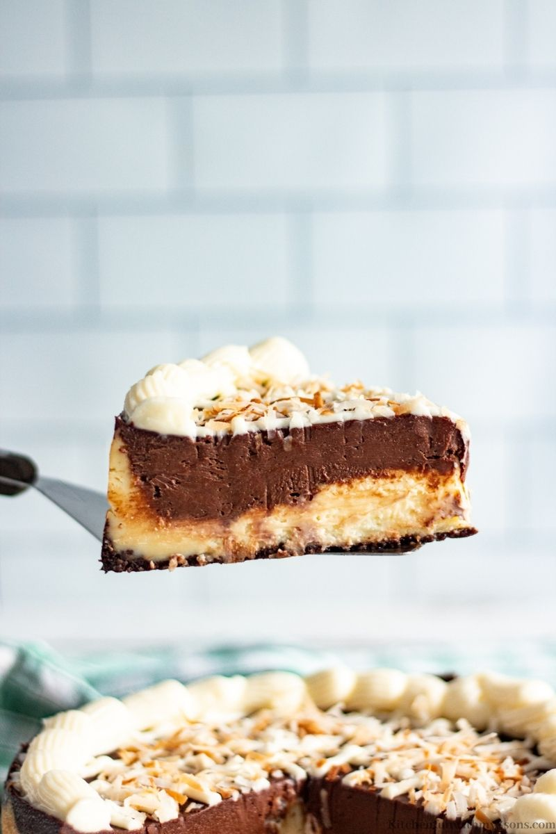 A spatula lifting up a piece of the chocolate swirl.