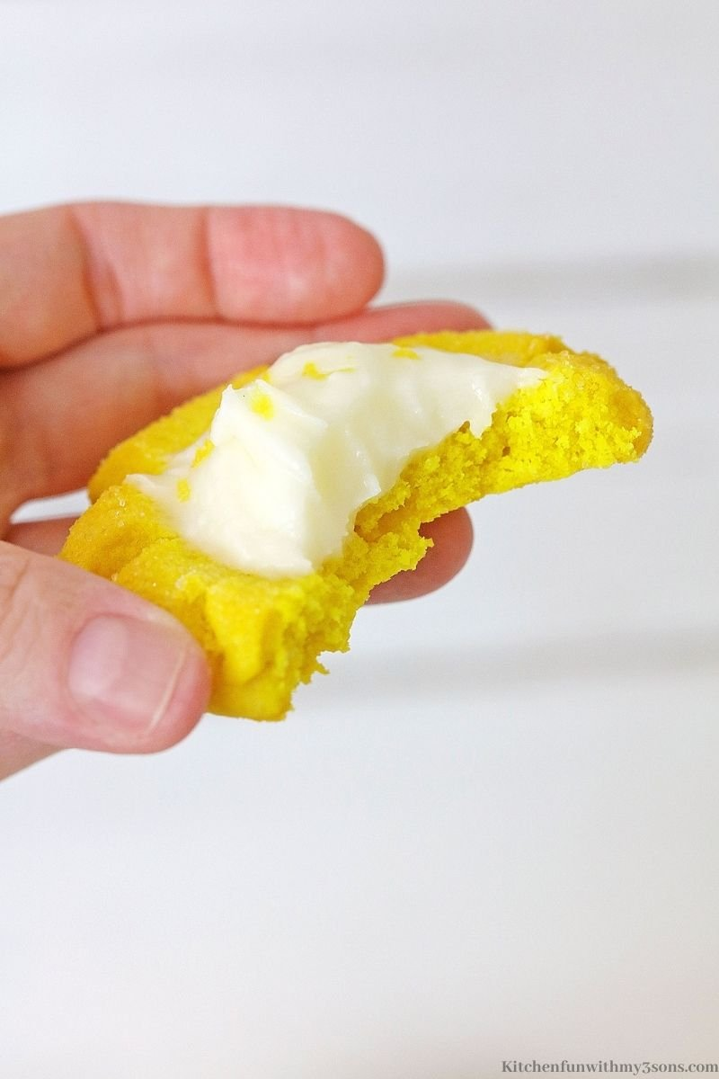 A lemon sugar cookie with a bite taken out.