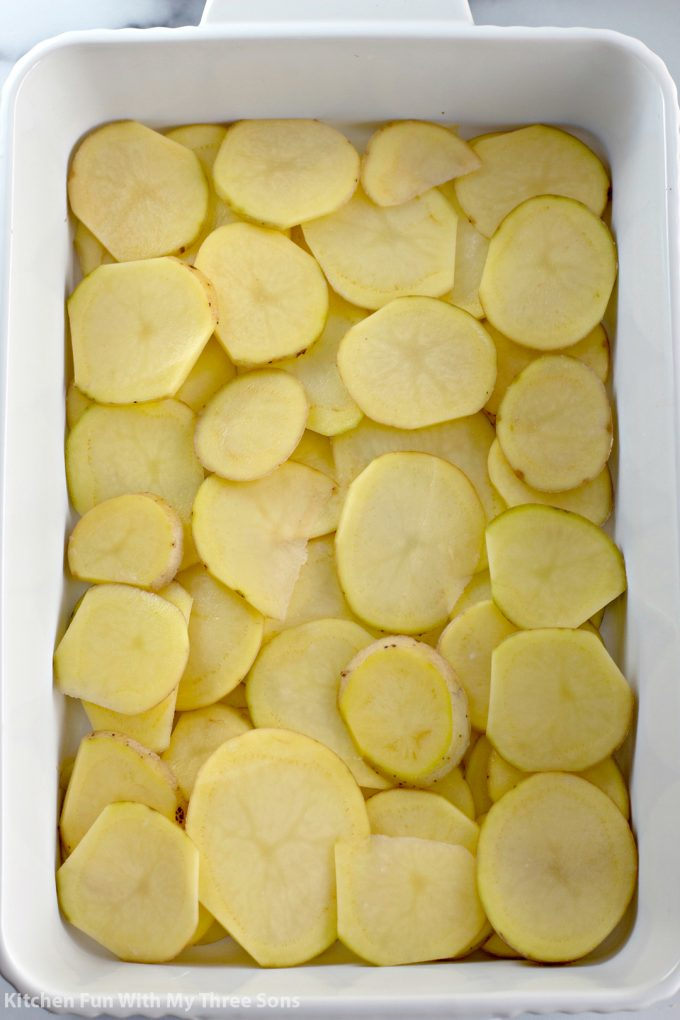 sliced potatoes in the casserole