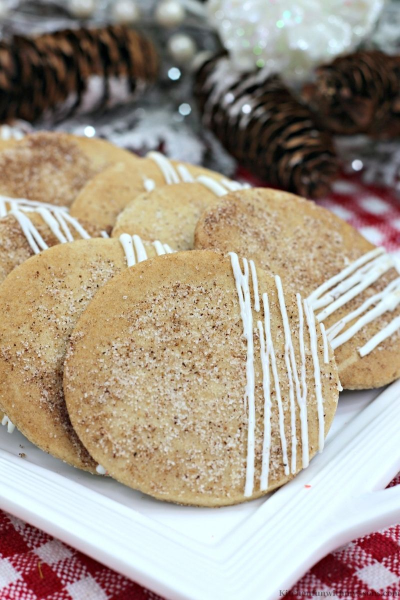 Maple Chai Sugar Cookies with pine cones behind it.