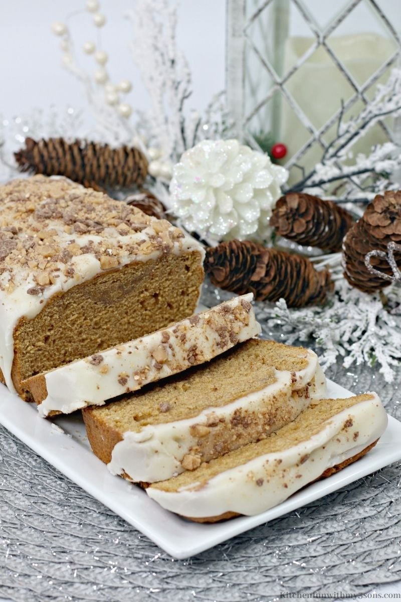Maple Sweet Potato Bread Recipe with pine cone decorations next to it.