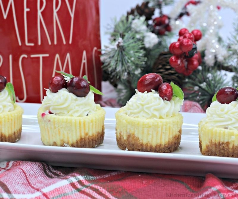 Mini White Chocolate Cranberry Cheesecake lined on a serving platter.