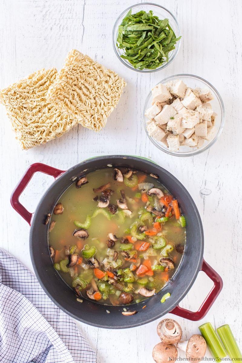 Adding the broth into the saucepan.