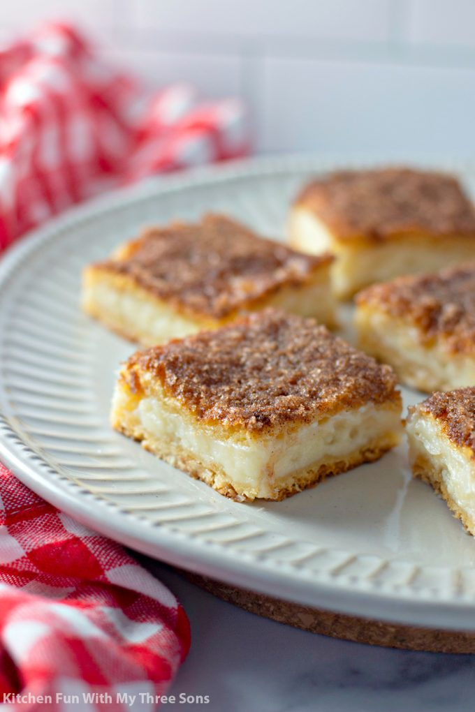 cut squares of Easy Sopapilla Cheesecake Recipe on a plate