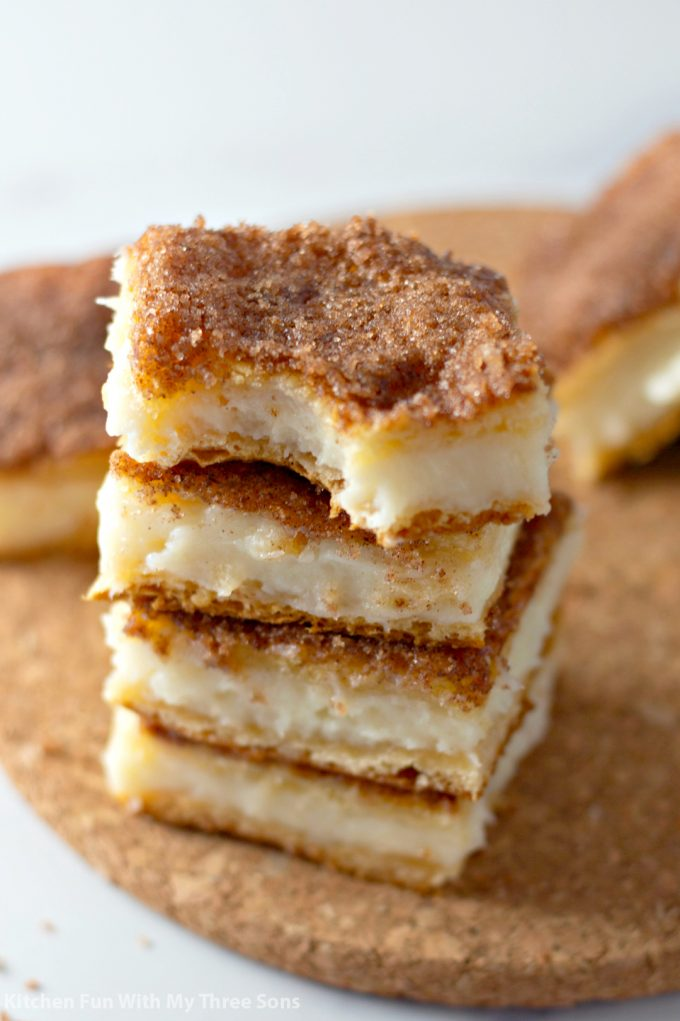 stacked sopapilla cheesecake squares with a bite taken out