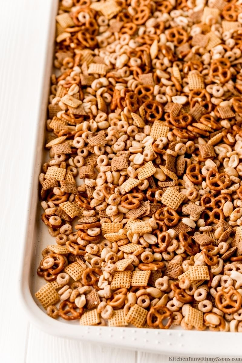 The Texas Trash Snack Mix spread out on a sheet.