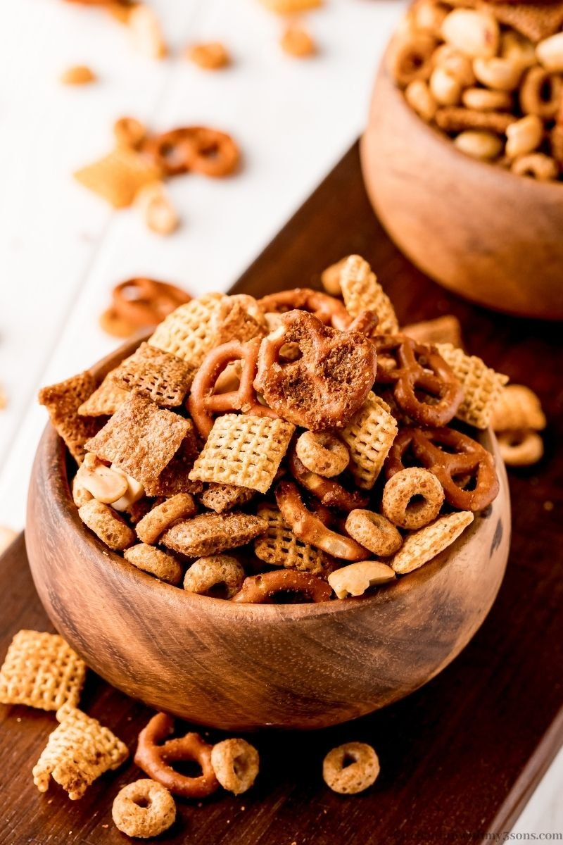 Texas Trash Snack Mix overflowing in a serving bowl.
