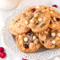 White Chocolate Cranberry Macadamia Nut Cookies are SO good! They are slightly crispy around the edge and the center is soft and chewy. Cranberries add a touch of tart while the white chocolate chips bring the sweet and the macadamia nuts add some crunch and a lovely flavor that brings everything together!